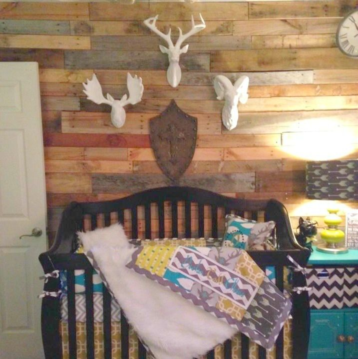 Rustic nurseries are so trendy right now and we love this amazing focal wall and faux taxidermy over the crib. Get the same look by heading over the The PN Shop for our great selection of faux taxidermy. {And double-secure anything over the crib!}