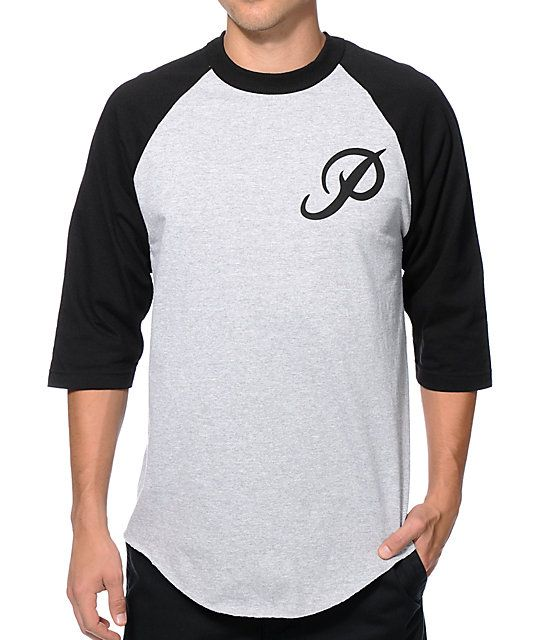 A clean and classic two tone style with a black Primitive classic P logo graphic at the left chest of a grey body accented by black 3/4 length raglan sleeves.