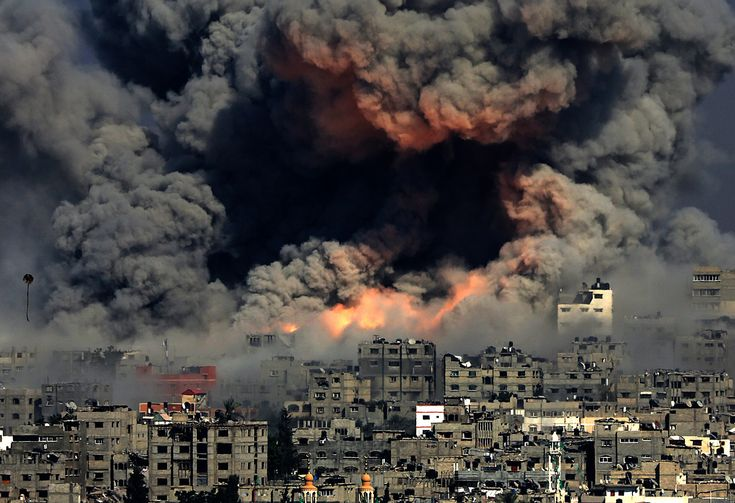74 Of The Most Amazing News Photos Of 2014:  Smoke rises from Tuffah neighborhood after Israeli air strikes in Gaza City on July 29. Mohammed Saber/EPA