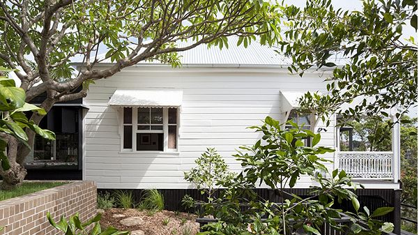 Exterior render and weatherboard. Dulux whisper white