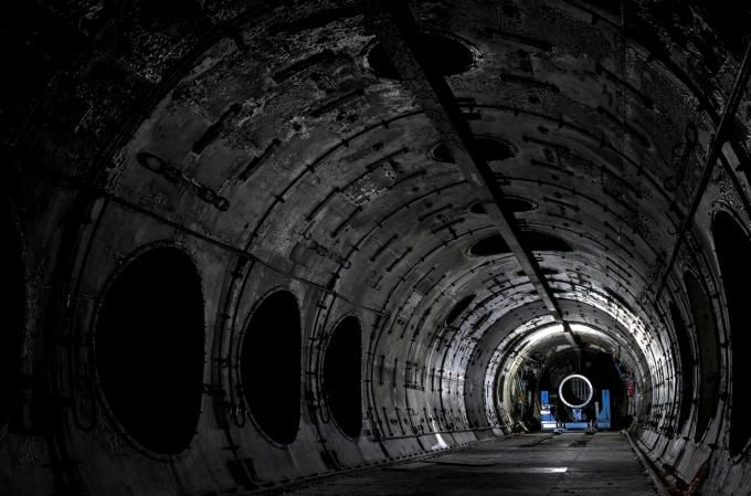 Within Cell 1 jet engine testing tunnel at the now demolished National Gas Turbine Establishment. Empty besides the jet nozzle at the far end. Photograph © Matthew Emmett. Click above to see larger image.