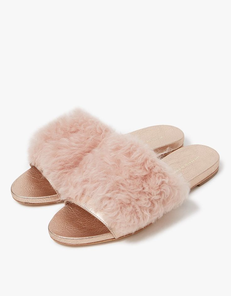 Open toe slide from Loeffler Randall in Pale Pink. Slip-on style. Leather lining. Tonal stitching. Padded footbed with gold-pressed logo.  • Real shearling fur upper • Leather sole • Made in Brazil • Women's sizes listed