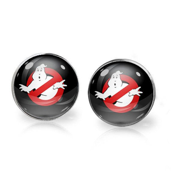 This listing is for ONE pair of Ghostbusters stud earrings. A perfect gift for the fangirl in your life!   These earrings measure 14mm in diameter and utilise glass domes to magnify high quality images set beneath. They are made using high quality surgical steel ear posts for sensitive ears. This listing is part of our Buy THREE get ONE free promotion. Purchase any three pairs of earrings in the promotion and receive one pair of your choice free. Please DO NOT add the free pair to your…