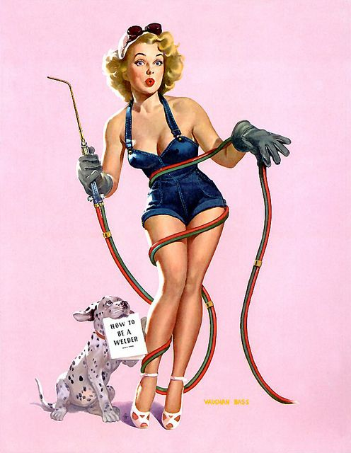 Vaughan Bass - blonde bombshell pin up girl learning to weld with help from her pet dalmation puppy