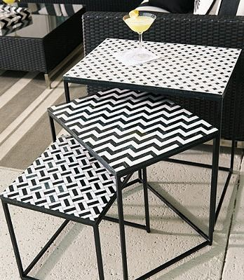 Black marble and white agate are the perfect contrast to one another, creating a set of outdoor nesting tables that are fresh, modern and cool.