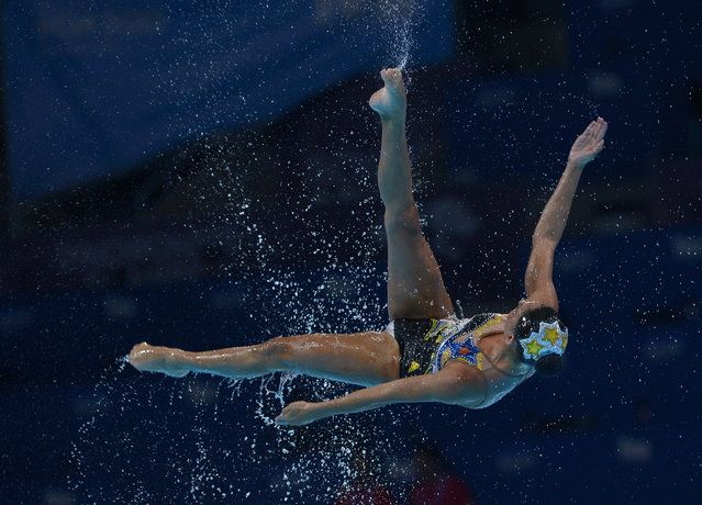 A Mexican swimmer is airborne as her team performs their routine in the synchronised swimming free combined event event at the FINA Swimming World Championships in Barcelona, Spain, Sunday, July 21, 2013. (Photo by Manu Fernandez/AP Photo)