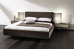 Contemporary double bed with integrated bed-side table