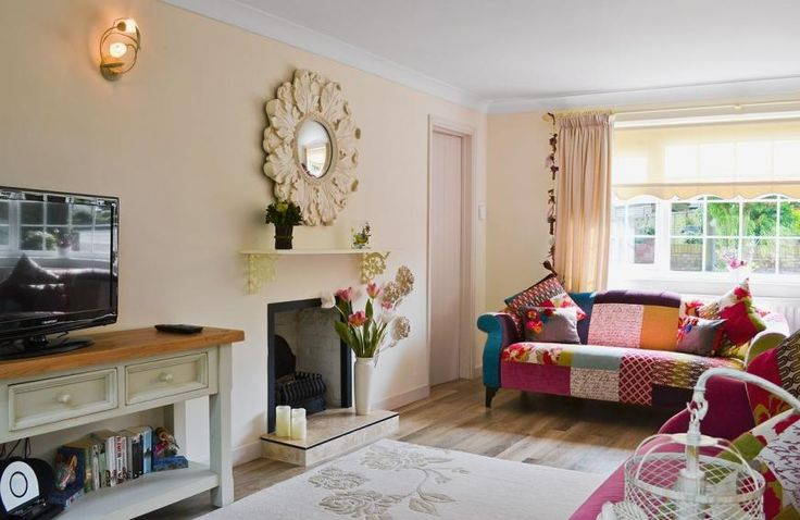 The vibrant living room of Captain's Cottage, Winterton-on-Sea. A luxury holiday cottage with 3 bedrooms. Find out more www.childfriendlyescapes.co.uk