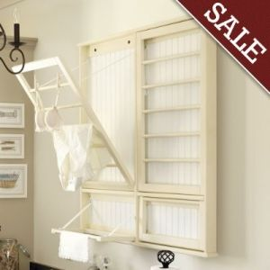 Love fold down racks for drying delicates... what about hanging them from the ceiling though, to save wall space for shelves?