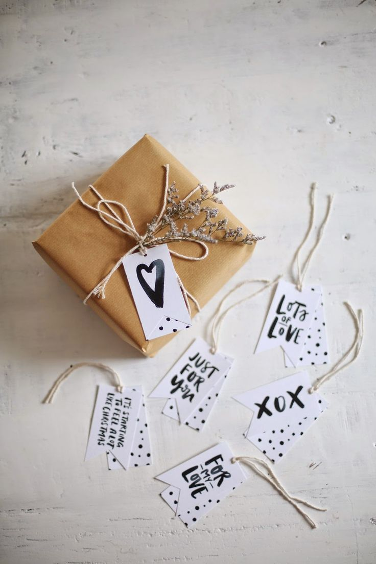 Gift wrapping // Brown paper, string, sprig and hand-lettered tags.