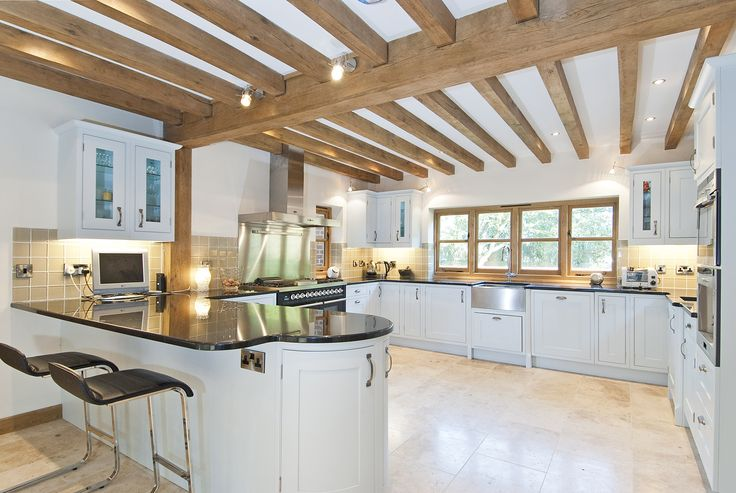 The exposed oak beams look beautiful in this kitchen, adding character as well as demonstrating how traditional construction techniques can work perfectly with a modern kitchen. #kitchenideas #oakframe #exposedbeams #modernkitchen #oakbeams