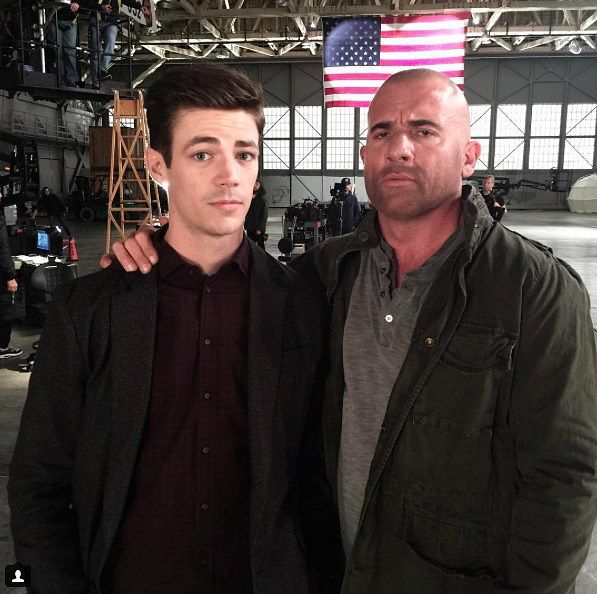 Grant Gustin and Dominic Purcell