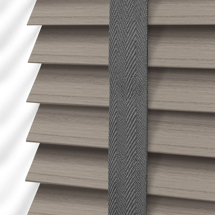 In gorgeous, smoky grey tones and authentic, wood grain effect, this Smoke Whisper faux wood blind is warm, neutral and incredibly contemporary. br  br The blind comes with a matching grey tape to ...