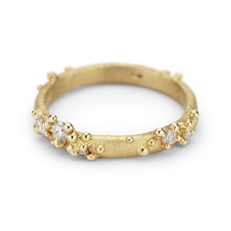 Unique Ruth Tomlinson alternative wedding band featuring white diamonds set amongst granules of yellow gold, handmade in London.