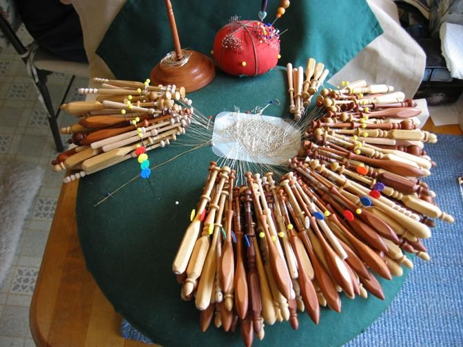 """Bobbin lacemaking. This particular piece has double or more than  the """"normal"""" number of bobbins for a piece of lace."""