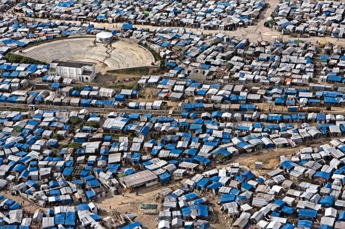 Port-au-Prince, Haiti. A view from the top of one refugee camp, in Port-au-Prince, after the big earthquake of 2010. Is possible to see that the area was a cemetery for old airplanes and helicopters: many people, now, live inside the junker.