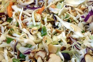This is Americanized fusion at its finest.  Dry instant ramen is broken up and used as a type of crouton in this shredded cabbage salad, and the sesame soy dressing is enhanced by adding the contents of the ramen seasoning packet.  The secret to keeping the ramen and almonds crunchy is to dry toast them in a pan and mix it in with the rest of the salad just before serving.
