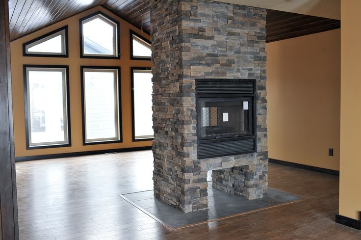 Custom fireplace in the Springfield RTM.   http://bailey-homes.ca/photo-galleries/2013-thespringfield/