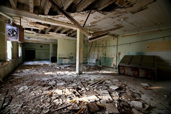 FL, old Boynton Beach High School - Some of the worst decay and damage is evident in the lunchroom, where fluorescent light fixtures dangle from the partially collapsed ceiling.