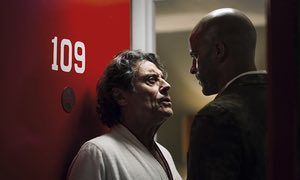 "This image released by Starz shows Ian McShane, left, and Ricky Whittle in a scene from, ""American Gods."" premiering April 30 at 9 p.m. (Jan Thijs/Starz via AP)"