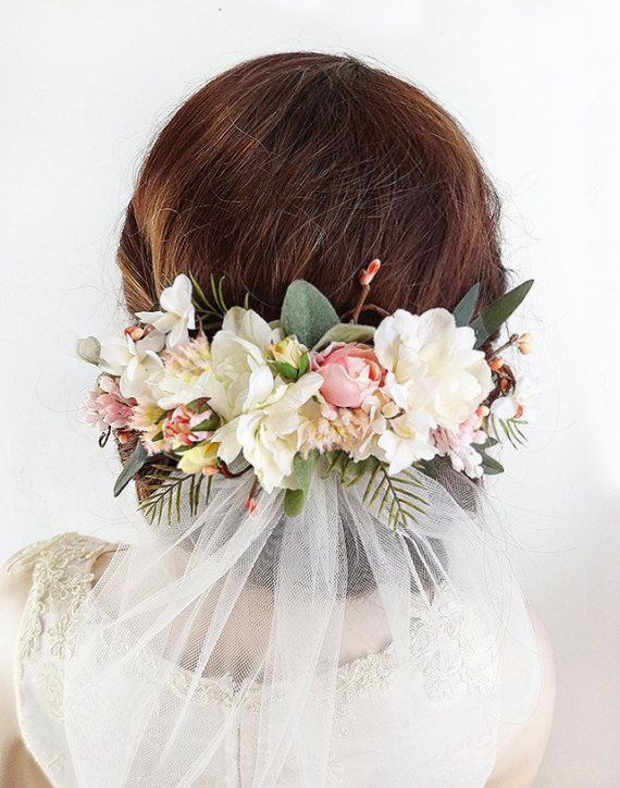 A spectacular floral hair clip to wear above your bridal veil. (Veil is not included with this listing; only showed for styling). Ideal for the bride who is torn between wearing a crown or a hair comb. Alternatively, I could add a simple round halo so you can wear this as a crown; please