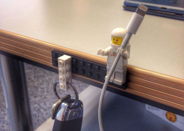 Lego man to hold cables.  Duplo guys could do the same for larger cords.