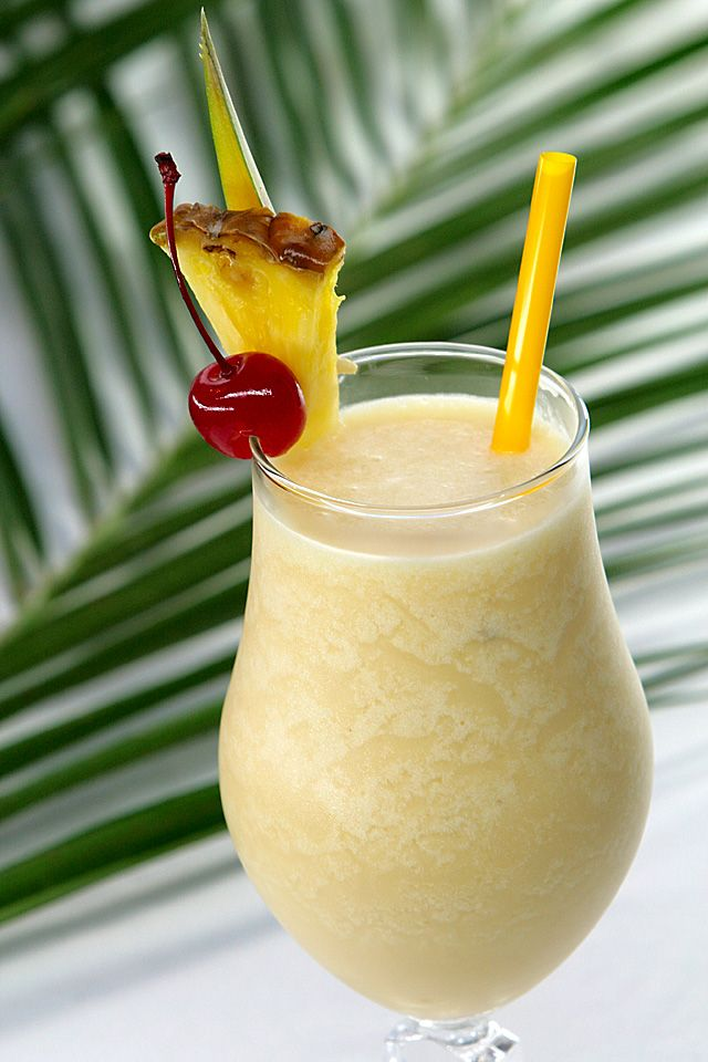The Pina Colada was invented in Puerto Rico. This is the classic recipe.  Add all ingredients to a blender and blend until well combined. Serve in attractive glasses garnished with pineapple slices. Recipe may be doubled or tripled.