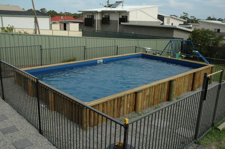 Permanent Pool with Rectangle Shaped Pool and Wooden Pool Frame also Gravel Pool Side Decorating for Above Ground Plunge Pool Design Ideas