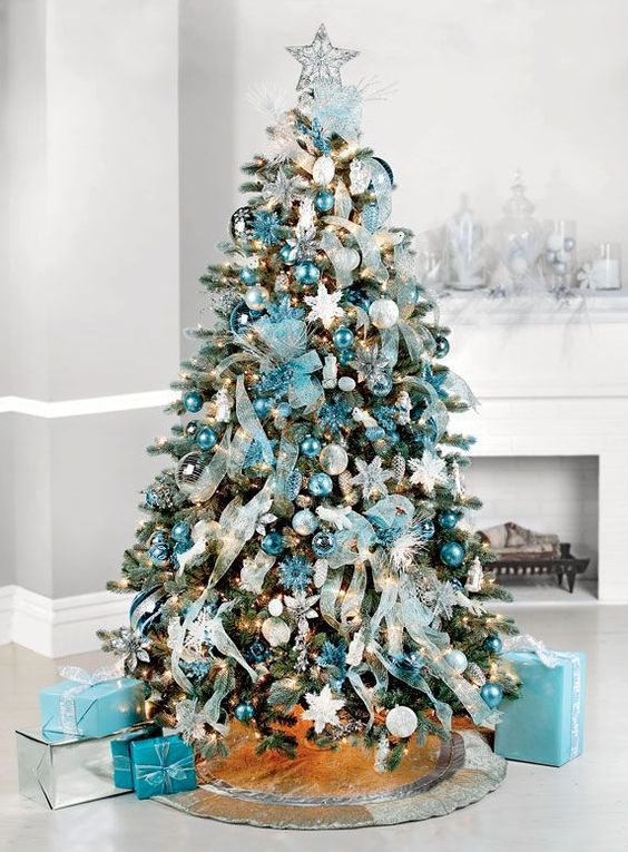 But if you truly want to stand out, we'd suggest you go for a blue Christmas tree this year. we've gathered a list of blue Christmas tree decoration ideas.