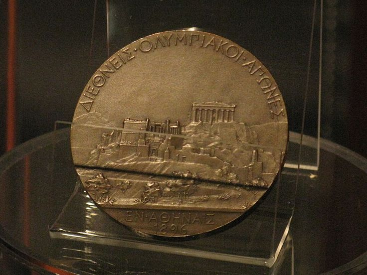 "A copper medal was given those in second place. The reverse features the Acropolis and, in Greek, ""International Olympic Games in Athens in 1896""."