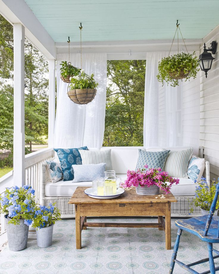 Reviving porch sitting - How to Decorate  - CountryLiving.com