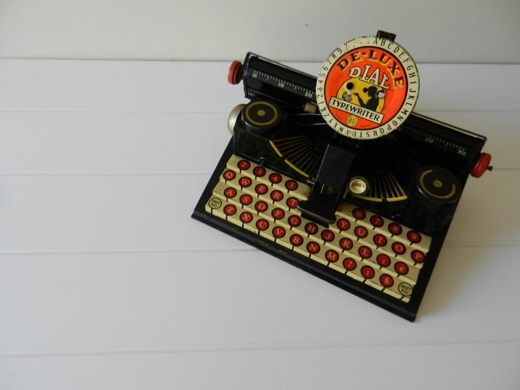 Vintage De-Luxe Dial Toy Typewriter / 1930's to 1940's. $37.50, via Etsy.