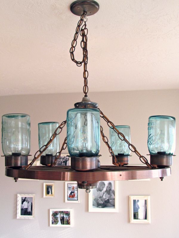 Lovely Wagon Wheel Light Fixture With Blue Mason Jars