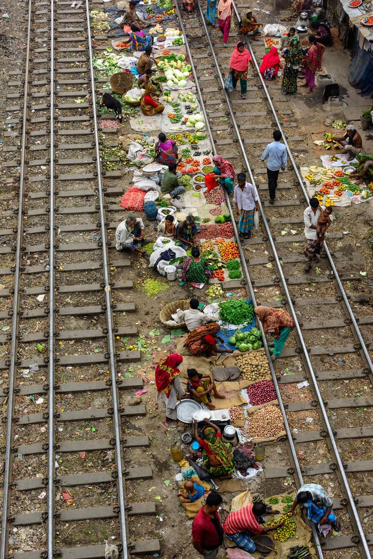 This is a portable vegetable market. When any train comes they just moved from their position. This is the cheapest vegetable market and mos...