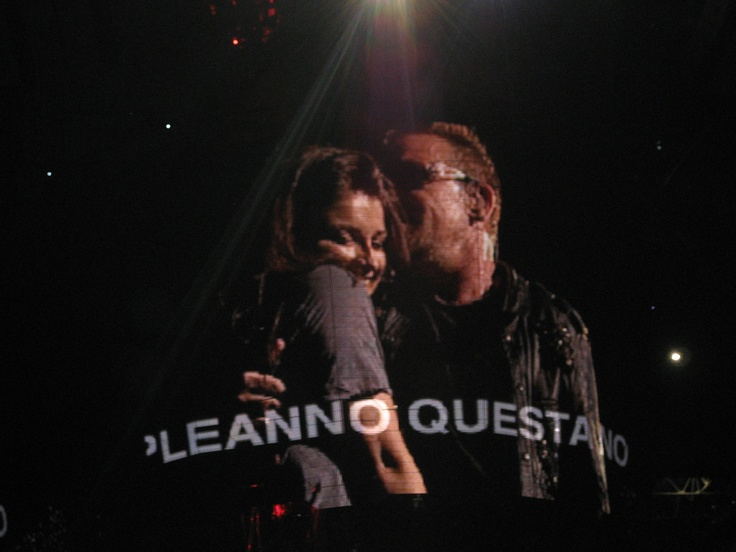 "U2 love their families. This is from the 360 tour in Milan, July 2009. Bono's daughter Eve was celebrating her birthday that day, and her dad called her onstage and tried to get the Italians to sing ""Happy Birthday"" (those are some of the words in Italian on the screen) and then he toasted her with a glass of champagne."