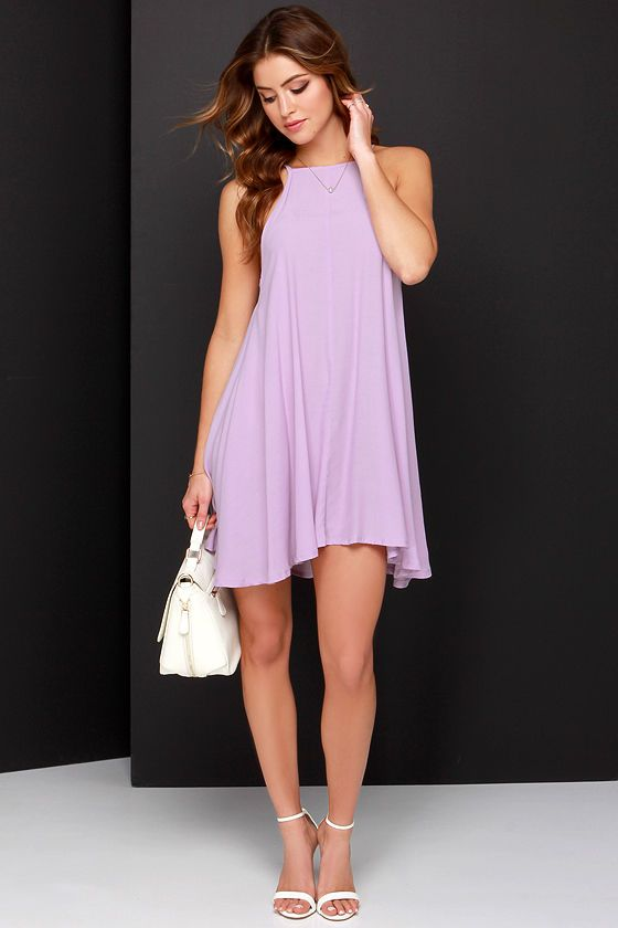 A sunny weekend filled with downtown strolls and picnics in the park, calls for the breezy Mink Pink Apron Lavender Swing Dress! Textured woven viscose-blend has a lightweight look and feel, shaping a squared-off halter neckline, and a shift bodice with wide arm openings. The flaring swing style skirt is chic and effortless. Unlined. 68% Viscose, 32% Acetate. Machine Wash Cold.