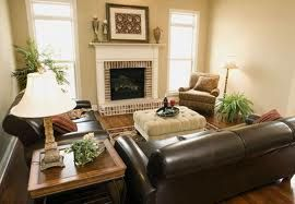 "How to decorate a room with dark brown leather furniture - keeping the room ""light"""