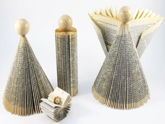 This modern Nativity is a tribute to a sacred moment of time. Each piece is carefully handcrafted by folding the pages of recycled books into a
