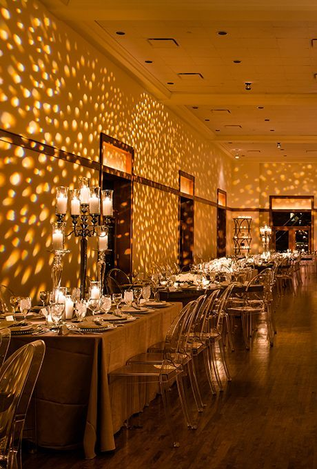 112ed07c0924 Brides.com  . This sleek and modern wedding reception looks like it was made  of gold