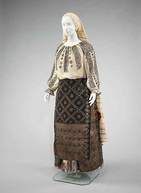 romanian ensemble - front Date: fourth quarter 19th century Culture: Romanian Medium: cotton, wool, metal, wool Dimensions: Length at CB (a): 22 in. (55.9 cm) Length at CB (b): 36 in. (91.4 cm) Length at CB (c): 47 in. (119.4 cm) Length at CB (d): 32 in. (81.3 cm) (e): 104 in. (264.2 cm) Credit Line: Brooklyn Museum Costume Collection at The Metropolitan Museum of Art, Gift of the Brooklyn Museum, 2009; Gift of Mrs. David Berks, 1959 Accession Number: 2009.300.2463a–e