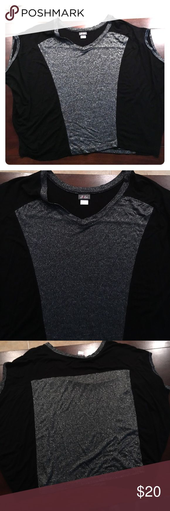 Black and silver Blouse Large black and silver Blouse! Made out of 95% Rayon/5% Spandex. Comes from a smoke free home Dots Tops Blouses