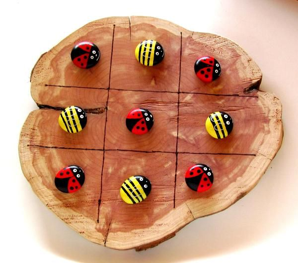"Fun tic tac toe board made from cedar, approximately 10"" across and 1/2"" thick, all board sizes will vary. Each board comes with 10 hand painted rocks and the lines are burned in. These can totally be"