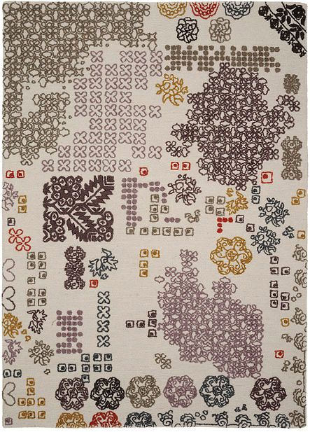 Raga is a patchwork of traditional, contemporary, unknown signs. Hand tufted hookwork carpet. 100% wool,