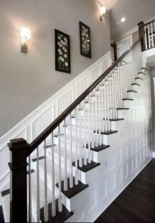 white and dark stair rail
