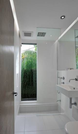 The sunken in tub is covered by a wooden grate for everyday showers. Original Article: latimesblogs.lati...