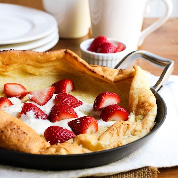 Dutch baby pancake with sweetened ricotta cheese and strawberries for brunch!