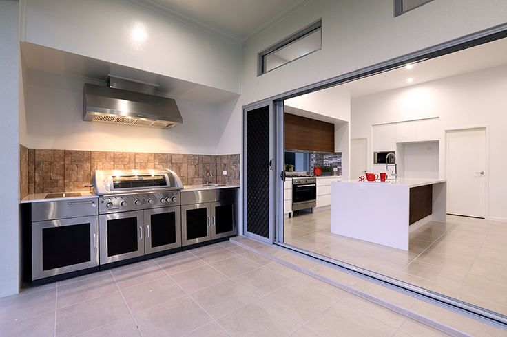 Outdoor entertainment ideas.  Dedicated BBQ area perfectly linked to the internal kitchen. The Stillwater 285 on display, Townsville. G.J. Gardner Homes. Australia