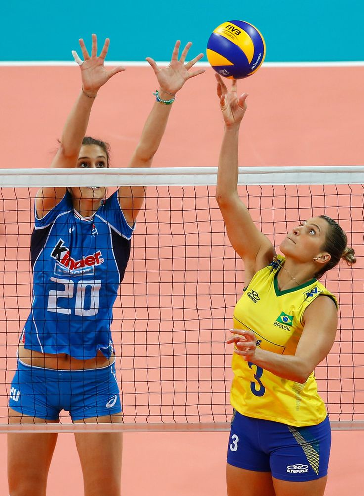 Dani Lins #3 of Brazil spikes the ball as Anna Danesi of Italy defend during the match between Brazil and Italy on day 1 the FIVB Volleyball World Grand Prix at Carioca Arena 1 on June 9, 2016 in Rio de Janeiro, Brazil.