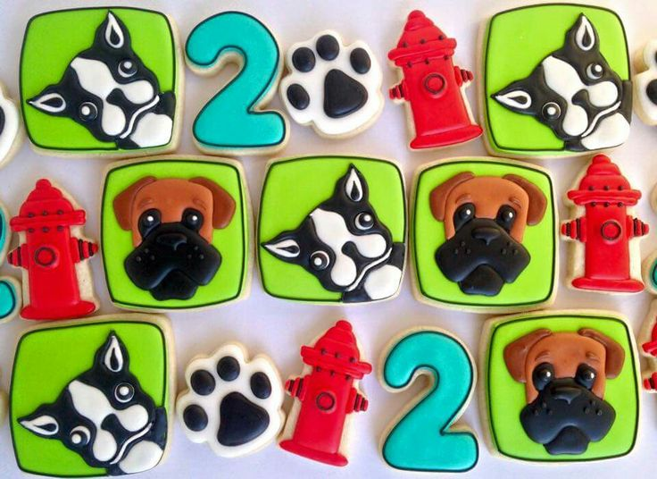 Laura Hill Watson:  Dog theme cookies.  Boston terrier.  Boxer. Paw.  Fire hydrant.