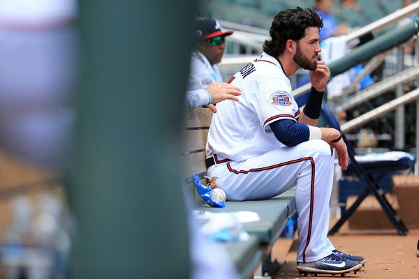 Dansby Swanson Photos Photos - Dansby Swanson #7 of the Atlanta Braves looks on from the dugout during the sixth inning against the New York Mets at SunTrust Park on June 10, 2017 in Atlanta, Georgia. - New York Mets v Atlanta Braves - Game One